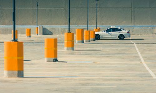 white sedan on parking lot during day time