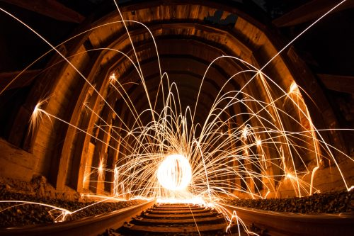 steel wool photography between concrete wall