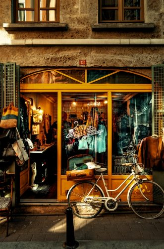 brown city bike beside brown wooden door