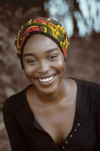 smiling woman wearing turban