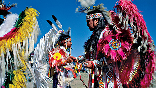 Photo by David Alan Harvey | Arizona | 1992 | Ceremonial dancers compete at a Native American powwow.