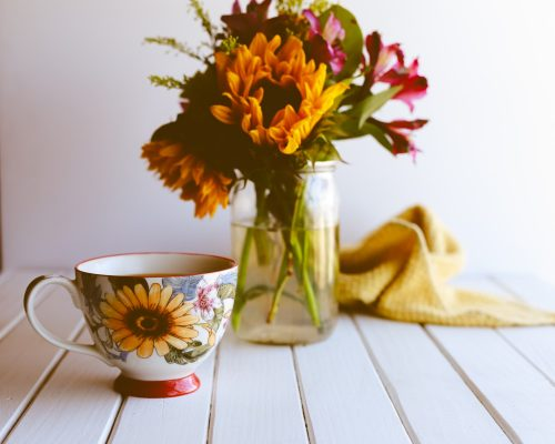 yellow and red flowers in clear glass vase