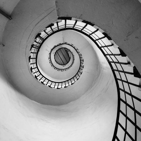 white spiral staircase with black metal railings